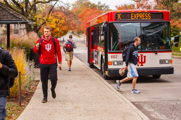 A group of IU Bloomington students getting off of the campus bus.